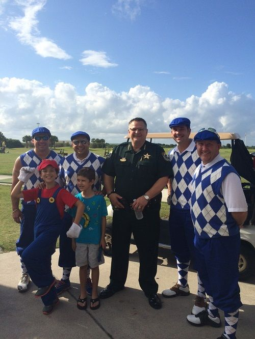 Members of Widerman Malek pictured with [url=http://www.brevardsheriff.com/home/meet-the-sheriff-wayne-ivey/]Sheriff Wayne Ivey[/url]. Mark Malek's sons were caddies for the event.