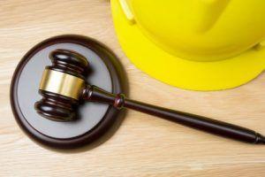 judge hammer and worker helmet
