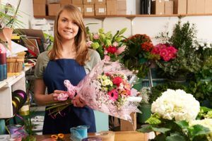Florist Working On Bouquet In Shop