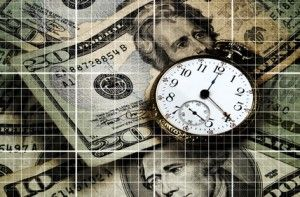 An old pocket watch over US currency. Grid lines throughout in this time and money concept image.