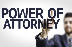 Business man pointing the text: Power Of Attorney