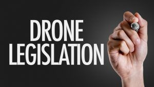 Hand writing the text: Drone Legislation