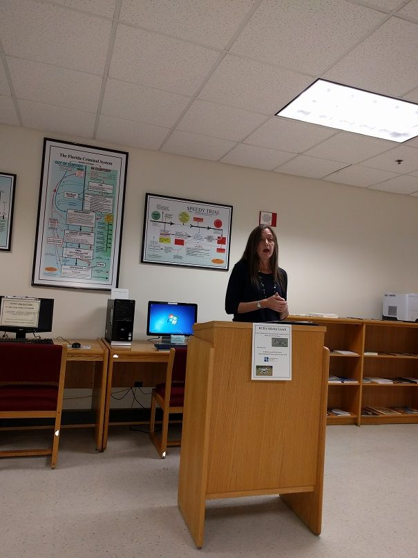 Kelly Swartz speaking at the Brevard Law Library