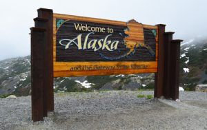 Welcome to Alaska sign on the Canadian / USA border near Skagway,