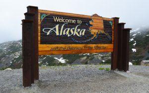 Welcome to Alaska sign on the Canadian / USA border near Skagway,