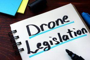 Drone Legislation written on a notepad with marker.