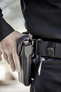 police officer law enforcement man with gun closeup